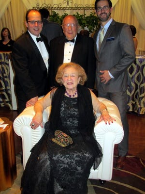 Seated Honey Scheidt and Paul Chandler (back row), Rudi Scheidt and Dr. Jordi Calzada were at the GPAC Gala.