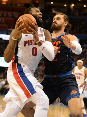 Pistons center Andre Drummond (0) drives to the basket against Thunder center Steven Adams (12) during the second quarter on Friday, Nov. 24, 2017, in Oklahoma City.