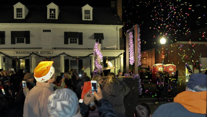 The celebrations begin to ring in 2015 during the annual Muskrat Dive New Year's Eve celebration in downtown Princess Anne.