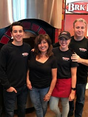 Randy and Carol Trombino, the owners of BRK Pizza in North Naples, with their children, Taylor and Michael.