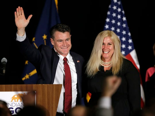 Todd Young, accompanied by his wife, Jenny, celebrates winning his Senate race on Nov. 8, 2016, in Indianapolis.