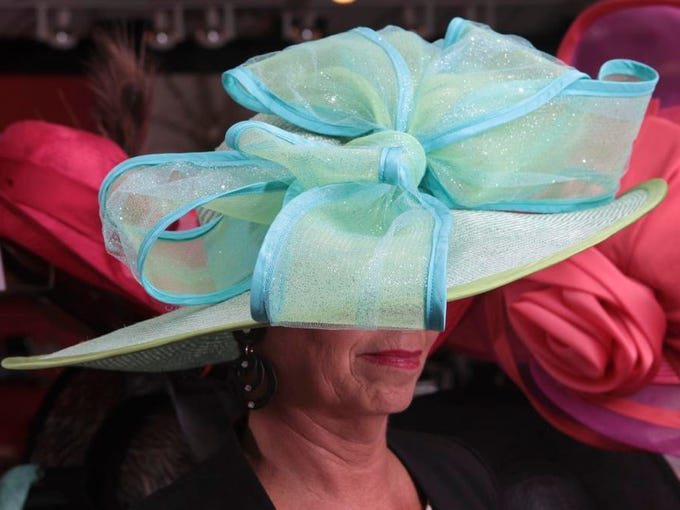 Patty Ethington models some of the millinery -- Derby hats in this case -- from designer Christine A. Moore at Rodes For Her. April 16, 2014