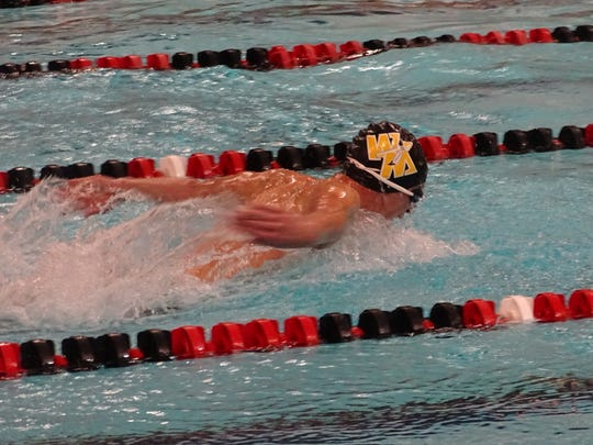 Watkins Memorial's Spencer Kleeh swims the butterfly in the 200 medley relay during a Jan. 2 meet against Granville and Northridge at Denison's Trumbull Aquatic Center.