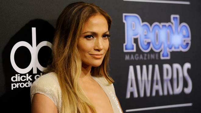 Jennifer Lopez arrives at The People Magazine Awards at the Beverly Hilton hotel, in Beverly Hills, Calif.
