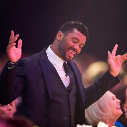 Seahawks quarterback Russell Wilson dances during a