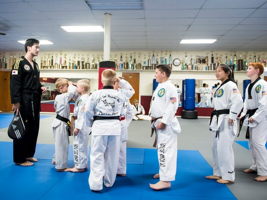 Members of So's Taekwondo competition team line up by height at the start of a training session on July 19, 2017. Students train at the Hanover studio year-round, three to six days a week.