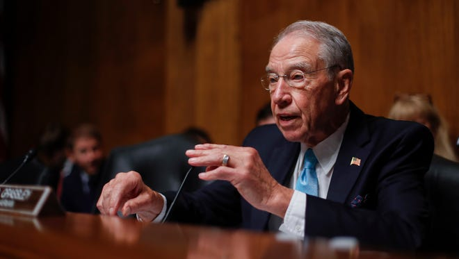 Senate Judiciary Committee Chairman Sen. Charles Grassley, R-Iowa gives opening remarks on Capitol Hill in Washington, Tuesday, Sept. 20, 2016, before the start of the committee's hearing on a proposed $66 billion merger of American seed and weed-killer company Monsanto and German medicine and farm chemical maker Bayer.