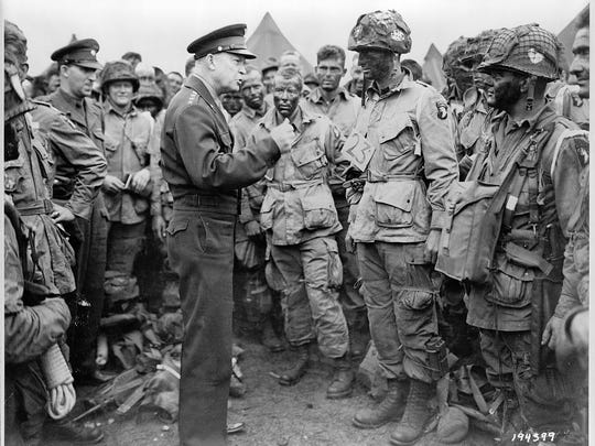 Gen. Dwight Eisenhower meets with members of 502nd Parachute Infantry Regiment, Company E of the 101st Airborne Division. Photo taken at Greenham Common Airfield in England about 8:30 p.m. on June 5, 1944.