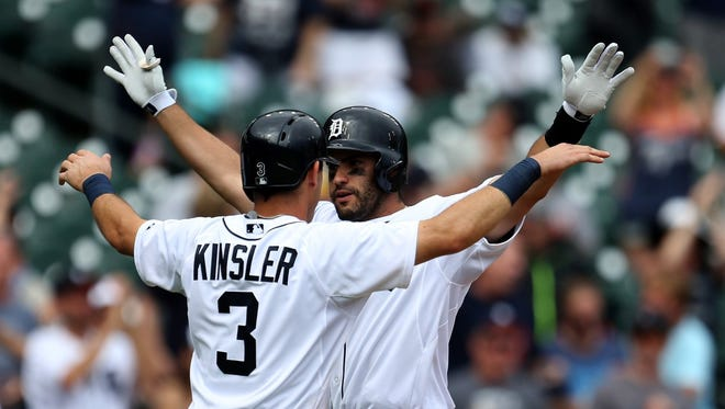 The Detroit Tigers rightfielder J.D. Martinez is met by Ian Kinsler after hitting a three-run homer against Cleveland Indians pitcher Scott Atchison during the sixth inning on Sunday, June 14, 2015 at Comerica Park in Detroit.