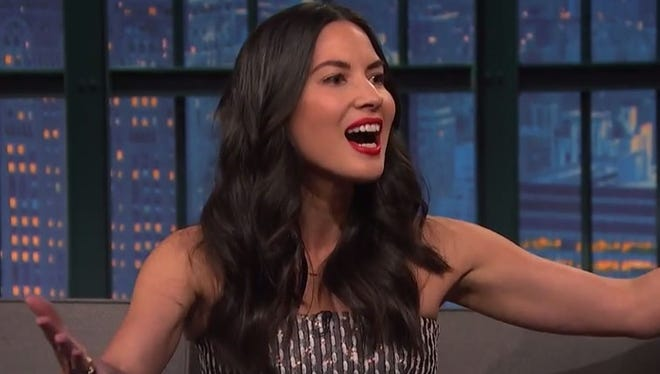 "Oliva Munn talked Aaron Rodgers, being a Green Bay Packers fan and her new puppy on ""Late Night with Seth Meyers'' on Tuesday."