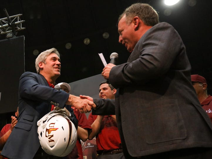 ULM coach Matt Viator presents Doug Pederson with a