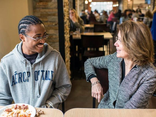New UNC-Asheville Chancellor Mary K. Grant speaks with freshman Kalen Doleman, of Charlotte, in the dining hall on the first day of class, Jan. 12.
