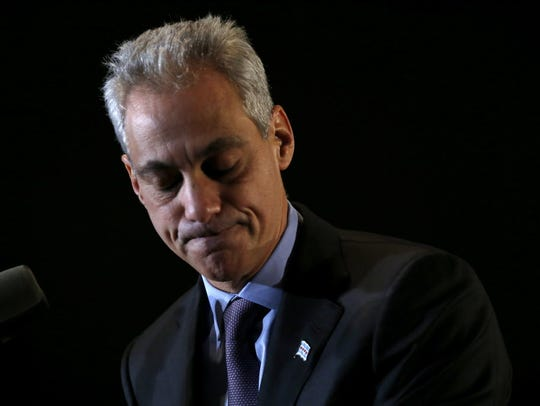 Chicago Mayor Rahm Emanuel pauses as he talks to supporters