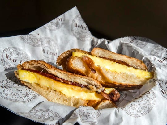 The bacon, egg and cheese sandwich on a croissant comes
