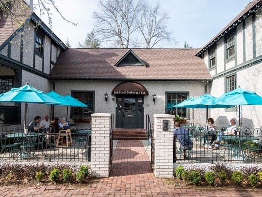 Well Bred Bakery in Biltmore Village features an outside