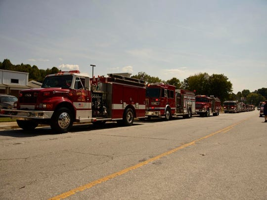 Firefighters bid final farewell to one of their own