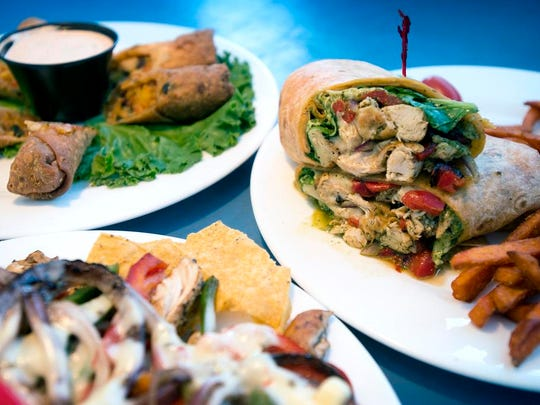 Clockwise from left: the Southwestern Spring Rolls, Tuscan Chicken Wrap and create a plate Tijuana Chicken at Blue Sky Cafe in Fletcher.
