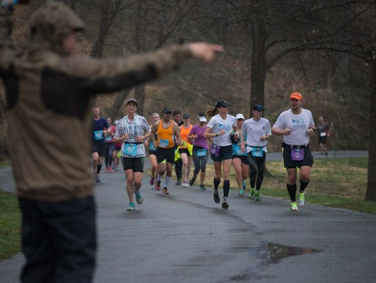 Runners endured downpours that were not short in duration