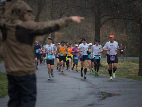 Runners endured downpours that were not short in duration during the soggy Asheville Marathon at Biltmore. 3/13/16- Pat Barcas