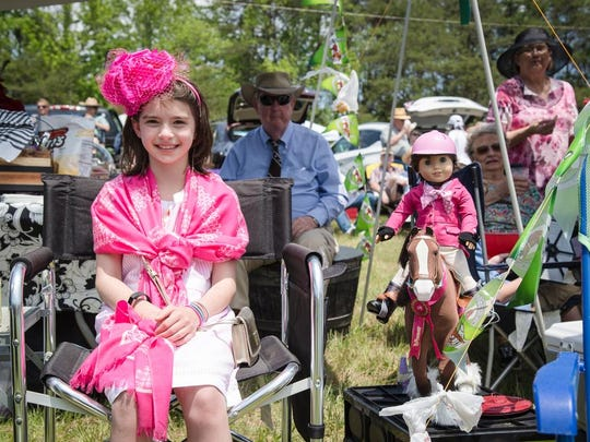 A celebration of the 70th running of the 2016 Block House Steeplechase Races at the Tryon Riding & Hunt Club included dove release, horse shows, fancy hats, colorful clothing,  fun for people of all ages, and horse races.