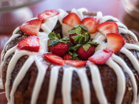Sweet Peach's signature Strawberry Dream Cake is made with fresh strawberries that are smashed, cooked and finally put into the cake.