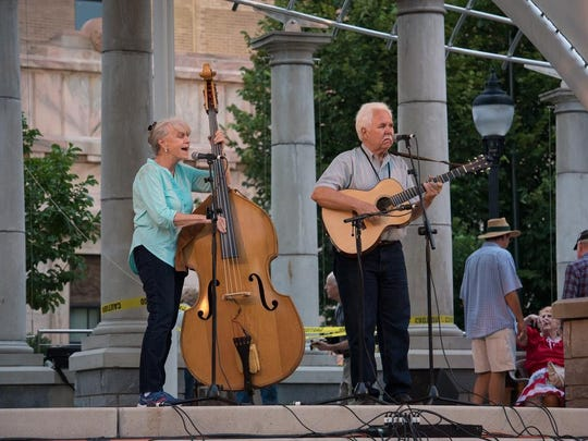 Mountain music and dancing kicked off this year's first Shindig on the Green on Saturday in downtown Asheville.