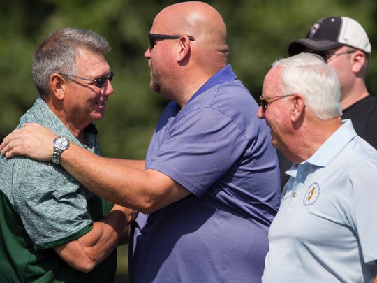 St. Joseph's athletic director Tony Karcich, left, greets North Jersey Super Football Conference President Joe Piro at the Green Knights game against Delbarton in September. NJSIAA Assistant Director Jack Dubois is on the right.