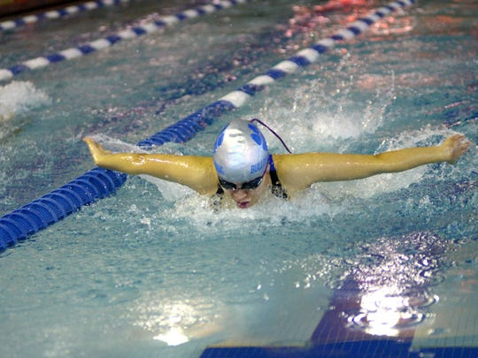 Passaic Tech's Vanessa Hernandez swims in the 400-yard freestyle relay during a meet against Ridgewood.
