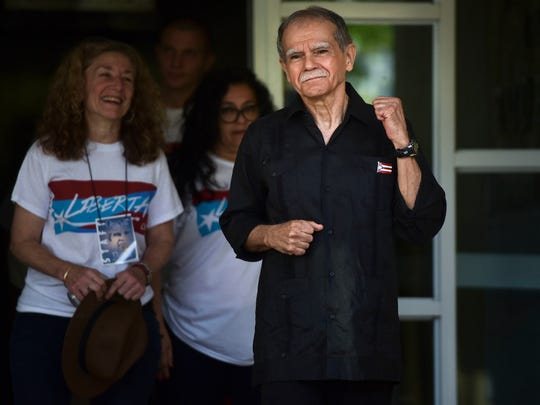 Puerto Rican nationalist Oscar Lopez Rivera gestures as he is released from home confinement after 36 years in federal custody, in San Juan, Puerto Rico, Wednesday, May 17, 2017. Lopez was considered a top leader of Puerto Rican militant group that said it was responsible for more than 100 bombings in several U.S. cities and Puerto Rico during the 1970s and early 1980s.
