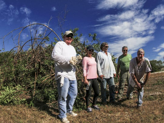 The most recent Pepper Bustin Party held in November features some of the fearless volunteers who came to rid their beloved Isles of invasive plants that choke the habitat for native plants and wildlife.  Luke Larson, coordinator of the event is on the far right.