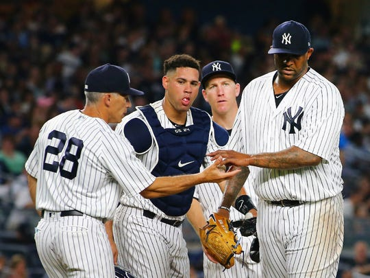 Yankees starter CC Sabathia hands the ball to manager