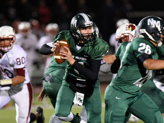 New Milford quarterback Ryan Picinic and the Knights