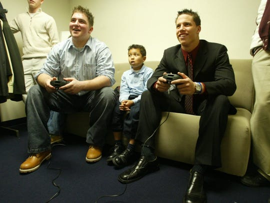 Brian Roche, left, and Brian Cushing, right, play a