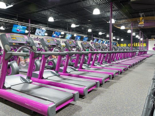 Planet Fitness members can watch television while working out on the treadmill. A new location in Milford is under construction and set to open late next month.