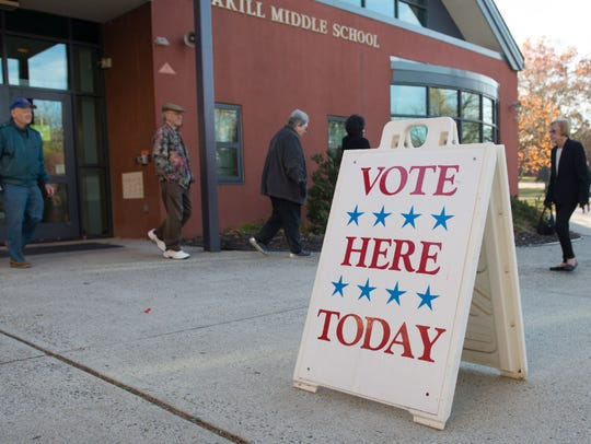 Voters at Tenakill Middle School in Closter cast their ballots on Nov. 8, 2016. New Jersey could soon start a process to register people to vote automatically, ending what supporters say is a roadblock for many looking to cast ballots.