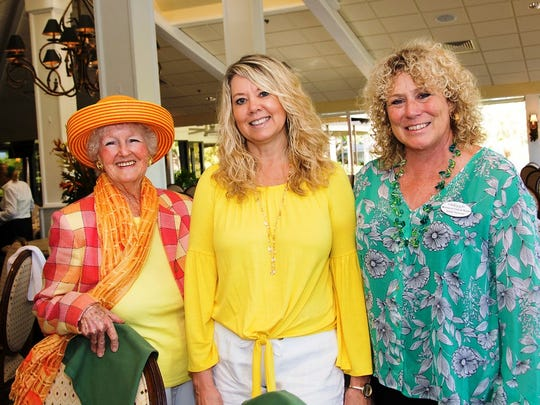 "Edithy Marcellis, left, Shelly Hammer and Angela Beausoleil take a break from modeling at the 2018 ""Food, Friends & Fashion"" luncheon presented by the Girlfriends Committee of the Woman's Club of Stuart."