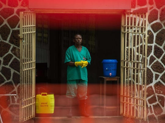 An attendant charged to handle the access to the Ebola