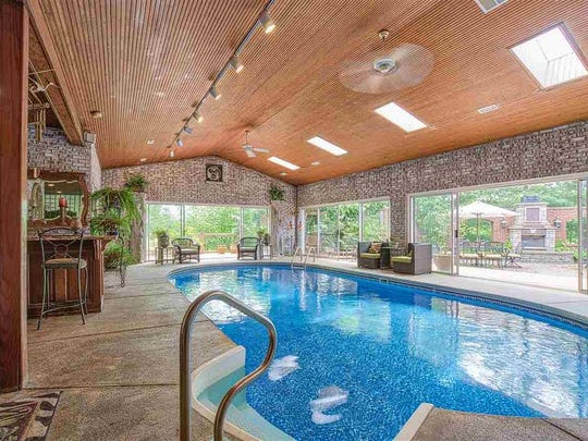 This lakefront home in Newburgh offers a  picturesque