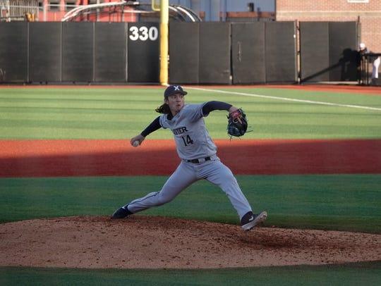 Xavier University freshman Lane Flamm pitches against