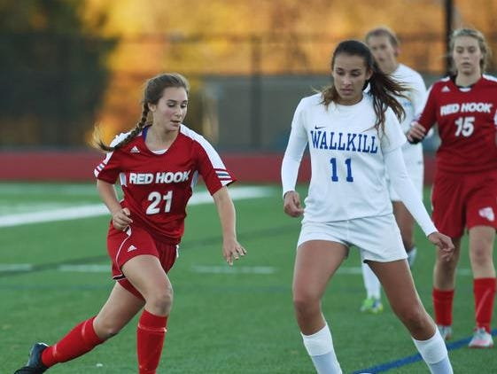 Red Hook's Lauren Engel, left, rushes the ball as Wallkill's Ashlan Hubbard, right, looks for an open teammate during the MHAL semifinal game at Franklin D. Roosevelt High School.