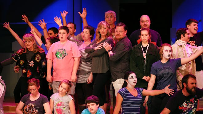 "The cast of ""The Addams Family"" rehearses at Pentacle Theatre."
