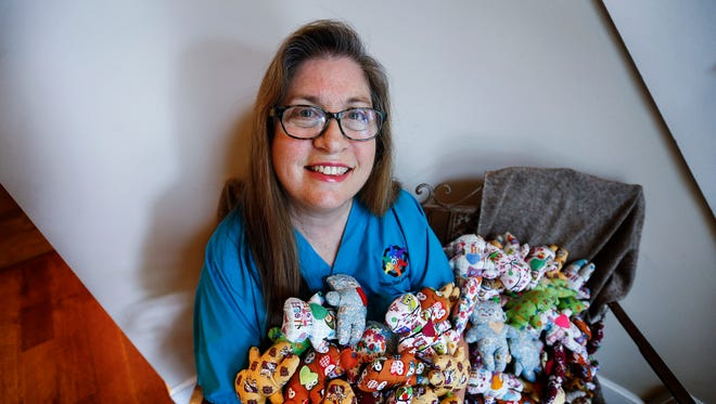 Tresha Mandel, director of Tikkun Olam Nicaragua, holds 200 handmade dolls sent to her from a teen in Thailand, who asked that they be handed out to Nicaraguan children on her next medical mission trip.