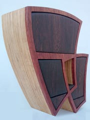 Conundrum, a furniture piece by Kerry Vesper, is part of the 'Makin' Furniture +' exhibit on display at the Vision Gallery in Chandler. The exhibit showcases hand-crafted furniture and artworks created by Arizona woodworkers, artists and craftsmen.