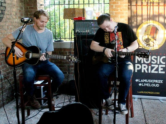 Shay Bailiff(left) and Micheal Brown of the band Shayliff playing during the Team Music Prize at Twisted Root Burger Company announcing the top 5 emerging bands that are competing for the Music Prize 2016 Winner's title in Shreveport on Thursday, September 9.