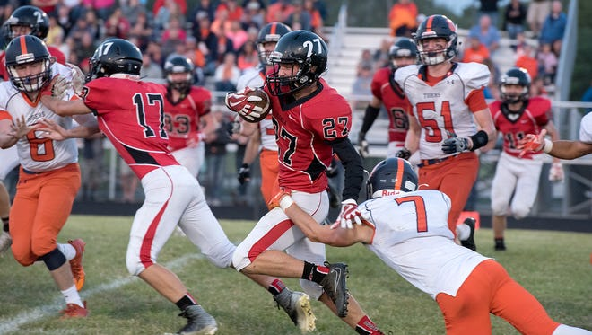 Galion's Tanner Crisman gets a hand on Bucyrus' Hastin Zier makes a long return run late in the second quarter. Galion won, 34 to 0.