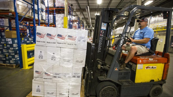Iowa Alcoholic Beverages Division forklift operator Chad Scherbring loads a case of liquor from Mississippi River Distilling Co. onto shelving at the Alcoholic Beverages Division warehouse in Ankeny on June 22.