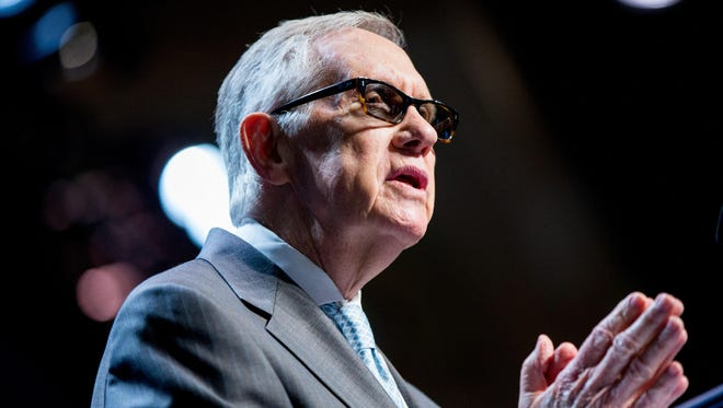 Senate Minority Leader Sen. Harry Reid speaks before introducing President Barack Obama at the National Clean Energy Summit at the Mandalay Bay Resort Convention Center on Aug. 24 in Las Vegas. The President used the speech to announce a set of executive actions and private sector commitments to accelerate America's transition to cleaner sources of energy and ways to cut energy waste.