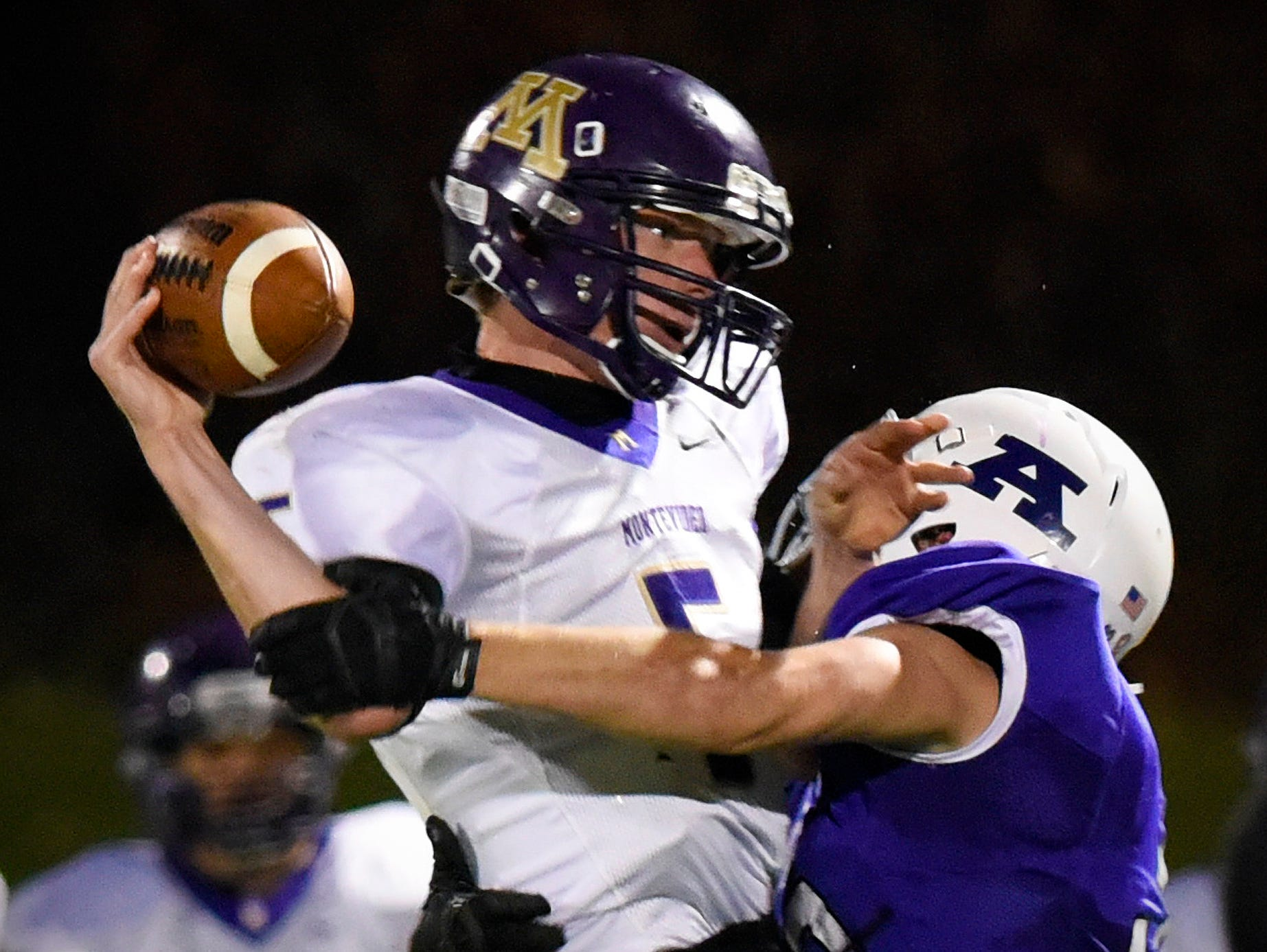 Albany's Kytle Birr hits Montevideo's quarterback Troy Diggins causing him to throw an interception during the first half Saturday, Oct. 24 at Husky Stadium.