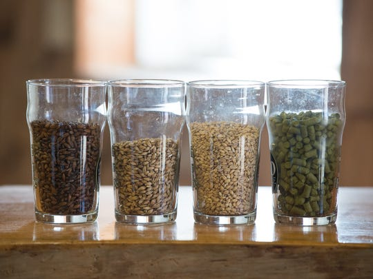 Beer ingredients at 16 Mile Brewery in Georgetown: (from left) pale chocolate malt, munich malt, wheat malt and hops in pellet form.