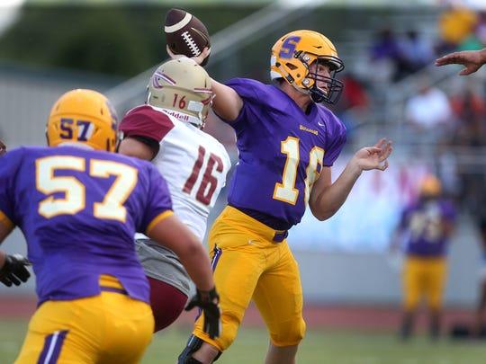 Smyrna's quarterback (18)John Turner passes tje ball during the first Jamboree game against Riverdale, at Blackman on Friday, Aug. 12, 2016.